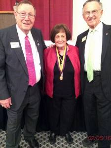 Lion PDG Carolyn Dorman (center) displays her Ambassador of Goodwill Award bestowed on February 6, 2016 in Kerrville, TX. She is flanked by PID Marshall Cooper (left) and PIP Edd Grindstaff (right).